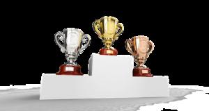 Un podium avec des coupes en or, argent et bronze.